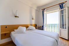 Chambre lits jumeaux vue sur mer