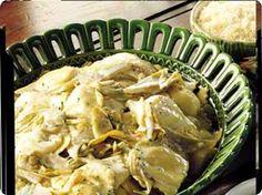 Ravioli di ricotta con salsa di carciofi.
