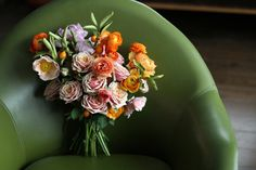 I love the colors and flowers used for this bouquet.  The green chair is a perfect backdrop too!