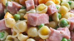 Ham, peas, Cheddar cheese cubes, and shell pasta are dressed in a mayonnaise, vegetable oil, and lemon juice dressing for a nice alternative to traditional pasta salads.