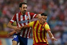 Juan Francisco Torres alias Juanfran of Atletico de Madrid commits a fault to Alexis Alejandro Sanchez of FC Barcelona during the Spanish Super Cup first leg match between Club Atletico de Madrid and FC Barcelona at Vicente Calderon Stadium on August 21, 2013 in Madrid, Spain.