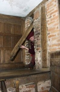 Harvington Hall. The ingenious Priest Hide in Dr Dodd's Library. This hide, behind a swinging beam,  would once have been hidden by paneling, book shelves and book cupboard doors.  The priest-hides were built in the time of Humphrey Pakington, at the end of the 16th Century,   when it was high treason for a Catholic priest to be in England.