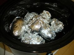 Complete Steak Dinner in CrockPot  Use a thick 3/4 inch steak  Pour a 1/2 cup A1 or Heinz 57 sauce over meat  cover with a layer of foil  add foil wrapped potatoes  and foil wrapped frozen corn cobs  cook on low for 6 hours  Full steak dinner any night of the week! This can also be done with thick pork chops or chicken breasts and BBQ sauce. The whole meal cooks in the slow cooker.