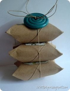 adorable way to gift wrap small things like jewelry. now i can throw away all those ugly white department store boxes i have been saving. Who knew it was as easy as grabbing the empty toilet paper roll! LOVE!
