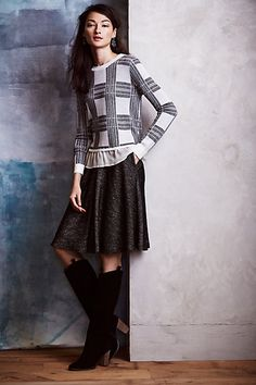 Plaid top with tweed skirt and knee-high boots