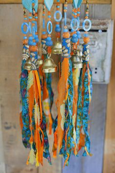 unique wind chimes-beads mobile-bell beads décor-windchimes-unique wind chime-outdoor garden decorations-suncatcher glass-bead suncatchers-sun catcher-sun chime I like the sound of bells and to look at sparkling crystal beads I love tassels and I make them from recycled clothes and scarfs One day I accidentally hung a tassel on the same nail of Mobile bells and saw that it was wonderful to combine them This mobile is made from wooden round surface covered with fabric, pompoms & embroidery...