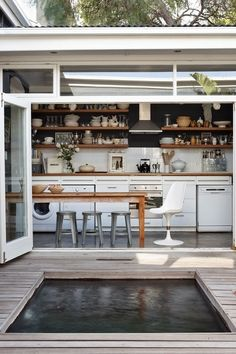 Indoor outdoor living space. Home/kitchen with table and sliding glass doors onto deck.