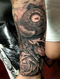 Clock rose key black grey arm tattoo