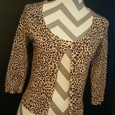 Classy Cardigan Leopard cardigan perfect for work and play!  3/4 length sleeve  In excellent condition.  77% acrylic  23% nylon Forever 21 Sweaters Cardigans