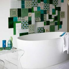 This gave me the idea, rather than using tiles,  to use small canvas hardboard wrapped in different fabric patterns in a single color family and hang in this manner.  Instant wall decor.