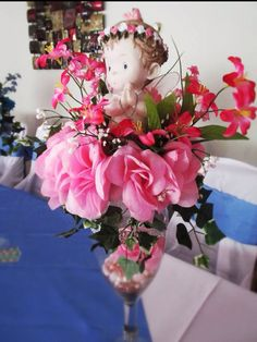 Beautiful #centerpiece for you #christening or presentation celebration with a #baby #angel seated  in a bed of pink or blue roses on top of a 14 inch tall Champagne glass. Thi... #religious #baptism #column #party #white #family #catholic