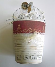 Food tin cans can be used for storage or garden containers, painted.