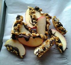 Chocolate-Granola Apple Wedges by robotheaertrecipes: Here is a super easy, low-guilt dessert or sweet snack. The recipe advises using a tart apple and semisweet chocolate. Also yummy with a sweet Honey Crisp apple and dark chocolate! #Snacks #Apple #Chocolate #Granola  I