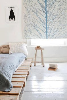 Pallet bed. Love this! Steve's bed has been on the floor forever (by choice) but painting the pallets black with his red/white decor would be cool :)