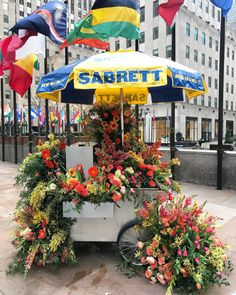 Sprawling Floral Installations Spill Over Garbage Cans and Phone Booths on New York City Streets | Colossal