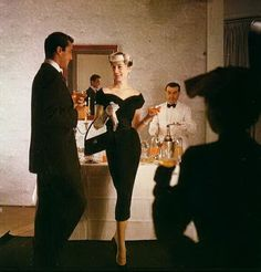 """A short while later at another cocktail party across town, my second one of the evening. Hank was flirting with Jeannie: That's how the """"Little Minx"""" knew, about Susie and Hank's split ! ;-)"""