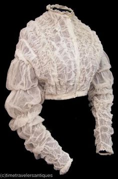 1860s white waist with puffed narrow sleeves. Looks to be net. This style of…