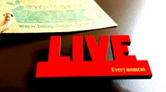 Wooden Inspirational 'Live Every Moment' Badge in red, white, orange, black and blue. Handmade jewellery, lasercut from upcycled wood. by BoughtoBeauty on Etsy