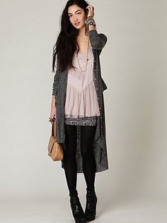 Slouchy somehow looks sharp here.  Dig the miniskirt under the flowy tunic/dress.