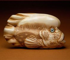 By Sergey Osipov, fish made of warthog tusk, with amber and mother of pearl inlay, 2010