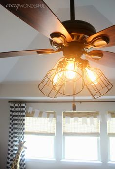 DIY cage light ceiling fan go to search metal light guard. There's a link on the site. Drum Light Fixture, Bedroom Light Fixtures, Bedroom Lighting, Bedroom Ceiling, Chandelier Fan, Black Chandelier, Tiffany Ceiling Fan, Dubai Miracle Garden, Ceiling Fan Makeover