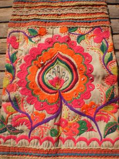 This is a beautifully embroided panel or apron. Old and unique and so collectable. Used as a decoration worn by Hmong tribe people. It would look so
