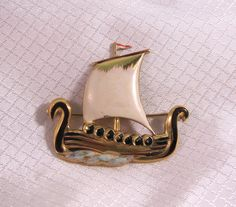 c1940's Coro Gold Plated Sterling Enameled Viking Ship Brooch by newoldjewels on Etsy