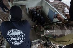 Two members of the French GIGN special forces look at members of the Brazilian elite military police unit BOPE training a hostage rescue operation, at their headquarters in Rio de Janeiro, Brazil, on June Military Police, Special Forces, The Unit, Training, Brazil, French, Swat, Service, Warfare