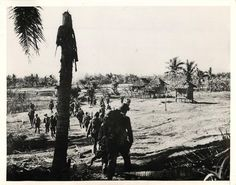 1945- U.S. infantrymen move through a wide valley in the Binmaley area of Lingayen Gulf during advance on Luzon.