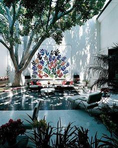 cool, dappled light and shadows (and Matisse's ceramic mural 'La Gerbe') in the courtyard of the Brody House, Holmby Hills, Los Angeles.  Courtyard designed by Garrett Eckbo, 1949