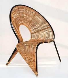 Rattan chair, Wladyslaw Wolkowsky - Circa 1950  Wow, what an art form of a chair!