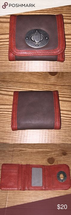 Brown and red leather wallet. Metal secure accent. Excellent condition. Many card spaces. One ID clear space. Another pocket behind ID pocket. Black and white patterned interior. A place for dollar bills & Receipts . Bags Wallets