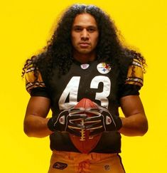 Troy Polamalu poses during a cover shoot for SI on Nov. He recently announced his retirement after 12 NFL seasons, all with the Pittsburgh Steelers. A two-time Super Bowl champion, Polamalu was one of the best safeties of his generation,. Pitsburgh Steelers, Pittsburgh Steelers Football, Pittsburgh Penguins, Football Poses, Troy Polamalu, My Dad Says, King Fashion, Nfl Season, Sports Figures