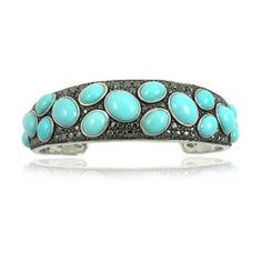 7 Sterling Silver Cuff Bracelet with Oval Turquoise Stones and Black... ($285) ❤ liked on Polyvore featuring jewelry, bracelets, cuff bangle bracelet, cuff bracelet, sterling silver cuff bangle, sterling silver bangles and turquoise stone jewelry