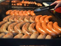 Polly's picks for must-eat treats at Oktoberfest. Photo: The Bahama Mama from Schmidt's of Columbus: a smoked pork and beef sausage. Enquirer file photo