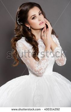 Beautiful Bride wedding makeup and hairstyle, vogue girl with long curly brown hair in white dress,  fashion model jewelry and beauty face, gorgeous arabian female, isolated , studio, series.