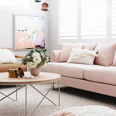 Modern Scandinavian living room with a pink velvet couch.