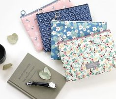 The *Medium Comely Pouch* is a lovely and useful pouch! There are 4 attractive styles to choose from, and its size and shape are great for storing your cash book, planner, makeup touchups, or feminine products! You can use it to organize your bag ...
