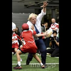 Mayor of London Boris Johnson bumps into a schoolchild during a Street Rugby event at Tokyo Square Gardens building in Tokyo, Japan, 15 October 2015, to mark Japan hosting 2019 Rugby World Cup. EPA/FRANCK ROBICHON/MaxPPP #photo #photos #pic #pics #picture #pictures #snapshot #art #beautiful #instagood #picoftheday #photooftheday #color #exposure #composition #focus #capture #moment #photojournalism #photojournalisme #politics