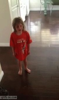 Unhappy girl accidentally  walks into wall