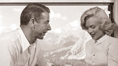 Romance: A rare, intimate moment between Marilyn Monroe and then-husband-to-be and baseball legend Joe DiMaggio.
