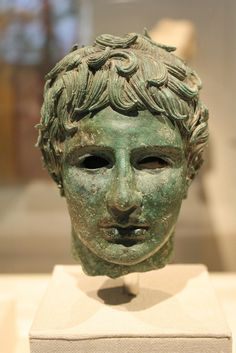 An Exceptional Late Hellenistic Bronze Head of a Young Man   Bronze, Late Hellenistic, ca. 2nd-1st century B.C.E.