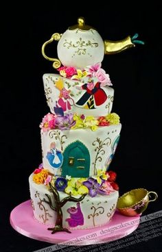 Todays cake of the day was sent in by iHeartSJ and is this really cool Alice in Wonderland cake! Isn't it amazing? It's got so much detail on it as well which really impresses me! It must of taken so long to make! I love how the cake is tilted too it gives the cake a bit more of a wacky effect doesn't it? What do you think of this cake?