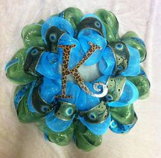 Green and Turquoise Deco Poly Mesh Wreath with peacock ribbon and leopard print letter $62.00