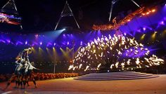 Dancers perform (L) as a phoenix rises with the Olympic flame being slowly extinguished at the closing ceremony of the London 2012 Olympic Games at the Olympic Stadium