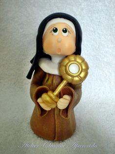 Santa Clara  modelada em biscuit com características infantis.  Elo7 - Atelier Claudia Aparecida