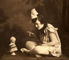 girl with kewpie doll