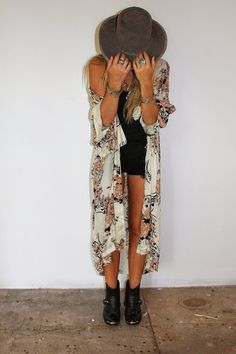 Boho accessories like a fedora, armful of bracelets and ankle boots look teamed with a print kimono.