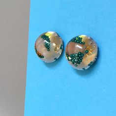 My own work. Mini sea shells and sparkle in resin ear studs.