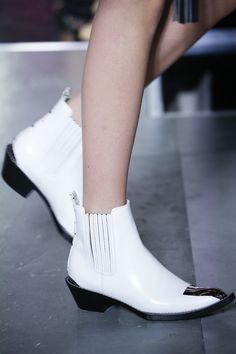 Next season will be all about punctuating your look with a bright white shoe or bag–like these from Louis Vuitton